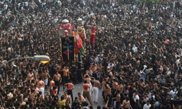 HEADLINE STORY - Shiite Muslim devotees take part in a procession to commemorate the death anniversary of Prophet Mohammad's companion and son-in-law Imam Ali in Lahore on May 4, 2021. (Photo by ARIF ALI/AFP via Getty Images)