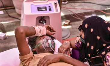 Covid in India - A covid patient receives free oxygen provided by a Sikh organisation, in Ghaziabad. (PTI Photo)