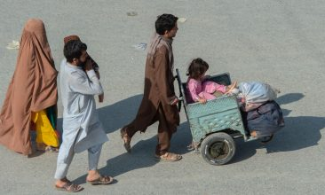 News - Afghan nationals make their way back across the Pakistan-Afghanistan land crossing border to Afghanistan in Torkham, some 54 Km from Peshawar on May 5, 2021. (Photo by ABDUL MAJEED/AFP via Getty Images)