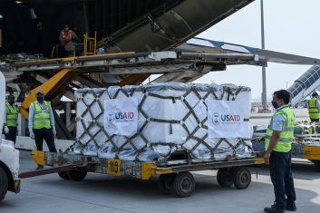 HEADLINE STORY - Ground staff unload Covid-19 coronavirus relief supplies from the US at the Indira Gandhi International Airport cargo terminal in New Delhi on April 30, 2021. (Photo by Prakash SINGH / POOL / AFP) (Photo by PRAKASH SINGH/POOL/AFP via Getty Images)