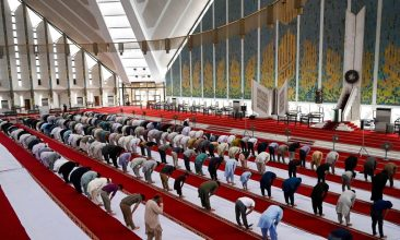 HEADLINE STORY - In this picture taken on May 3, 2021, Muslims offer a prayer at the Grand Faisal Mosque in Islamabad amid the Covid-19 coronavirus pandemic. (Photo by AAMIR QURESHI/AFP via Getty Images)