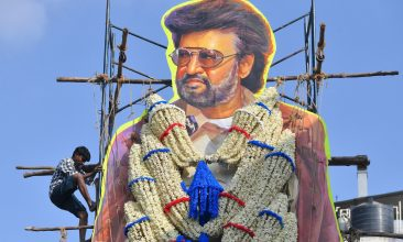 Entertainment - A worker garlands a 30 feet cut-out of actor Rajinikanth (Photo by MANJUNATH KIRAN/AFP via Getty Images)