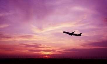 BANGLADESH - Beautiful silhouette of airplane on sunset background.