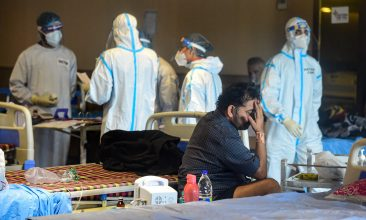 Covid in India - Health workers examine patients receiving treatment inside a banquet hall, converted into a Covid-19 isolation centre, in New Delhi. (PTI Photo)
