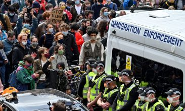 HEADLINE STORY - Protestors block a UK Home Office van to stop it from leaving Kenmure Street in First Minister Nicola Sturgeon's constituency on May 13, 2021 in Glasgow, Scotland. (Photo by Jeff J Mitchell/Getty Images)