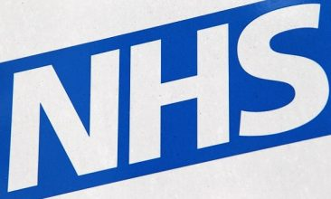 HEALTH - The NHS logo on a sign outside St Thomas' Hospital   (Photo by Oli Scarff/Getty Images)