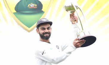 CRICKET - Virat Kohli of India poses with the Border–Gavaskar Trophy as he celebrates India's 2-1 series win after day five of the Fourth Test match in the series between Australia and India at Sydney Cricket Ground on January 07, 2019 in Sydney, Australia. (Photo by Mark Kolbe/Getty Images)