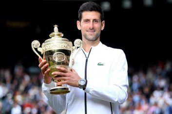 Coronavirus - Novak Djokovic poses with the trophy as he celebrates winning the final against Switzerland's Roger Federer (Laurence Griffiths/Pool via REUTERS).