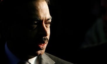 Business - FILE PHOTO: Pramod Mittal speaks during a news conference in Kremikovtzi, near Sofia. REUTERS/Stoyan Nenov/File Photo
