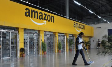 INDIA - FILE PHOTO: An Indian employee cleans the floor inside Amazon's largest Fulfillment Centre (FC) in India, on the outskirts of Hyderabad.  (AFP PHOTO / NOAH SEELAM)