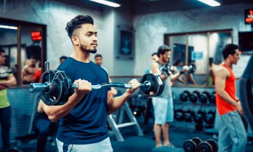 Coronavirus - India, Fitness, Healthy Lifestyle - Indian man lifting weights at a fitness centre