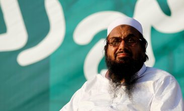 """HEADLINE STORY - FILE PHOTO: Hafiz Muhammad Saeed, chief of the banned Islamic charity Jamat-ud-Dawa, looks over the crowd as they end a """"Kashmir Caravan"""" from Lahore with a protest in Islamabad, Pakistan July 20, 2016. REUTERS/Caren Firouz/File Photo"""