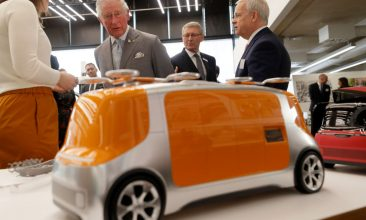 Business - Prince Charles checks out a concept car model at the Tata JLR National Automotive Innovation Centre. (Photo: Getty Images)