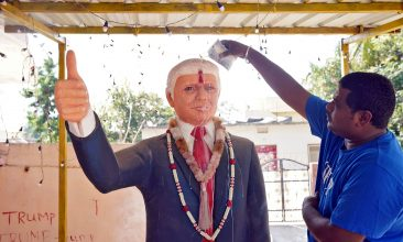 HEADLINE STORY - FILE PHOTO: Bussa Krishna, a fan of US president Donald Trump, offers prayers to a statue of Trump at his house in Konney village in the southern state of Telangana, India, REUTERS/Vinod Babu.