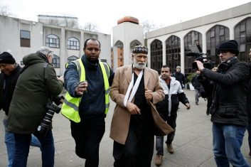 News - Muazzin Rafat, (R), who was stabbed whilst praying in the mosque the previous day, arrives for Friday Prayers at London Central Mosque near Regent's Park in London on February 21, 2020 (Photo: TOLGA AKMEN/AFP via Getty Images).