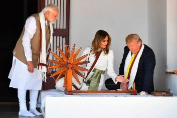 HEADLINE STORY - US President Donald Trump (R) and First Lady Melania Trump sit next to a charkha, or spinning wheel, as India's Prime Minister Narendra Modi (L) looks on during their visit at Gandhi Ashram in Ahmedabad on February 24, 2020. (Photo by MANDEL NGAN/AFP via Getty Images)