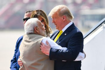HEADLINE STORY - India's Prime Minister Narendra Modi (L) embraces US President Donald Trump upon his arrival at Sardar Vallabhbhai Patel International Airport in Ahmedabad on February 24, 2020. (Photo by MANDEL NGAN/AFP via Getty Images)