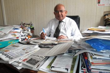 Comment - Ramniklal Solanki at his desk at AMG offices.