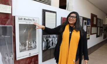 FEATURES - In this picture, human rights award winner and founder of Pakistan's first cyber-harassment helpline, Nighat Dad, looks at a picture gallery at the ASR Resource Centre in Lahore. (AFP)