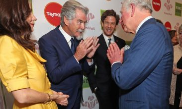 News - Prince Charles uses the namaste gesture to greet Anna Friel and Pierce Brosnan at the recent Prince's Trust and TK Maxx & Homesense Awards at London Palladium. (Photo: Yui Mok/Getty Images)
