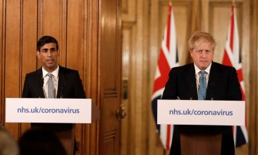 HEADLINE STORY -  Britain's Chancellor Rishi Sunak, (L) and British Prime Minister Boris Johnson give a press conference about the ongoing situation with the coronavirus (COVID-19) outbreak inside 10 Downing Street on March 17, 2020. (Photo by Matt Dunham - WPA Pool/Getty Images)