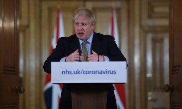 Coronavirus - British prime minister Boris Johnson gestures as he gives a press conference about the ongoing situation with the coronavirus (COVID-19) outbreak inside 10 Downing Street on March 18, 2020 in London, England. (Photo by Eddie Mulholland - WPA Pool/Getty Images)