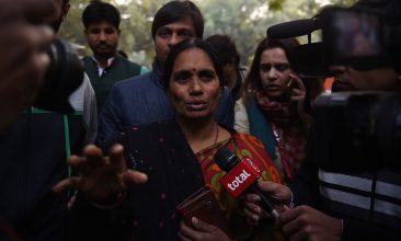 INDIA - FILE PHOTO: The mother of Indian gangrape victim 'Nirbhaya' (C) talks to the media as she attends a rally held to protest the release of a juvenile rapist, in New Delhi (MONEY SHARMA/AFP via Getty Images)