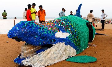 News - File photo of people walking past a large-scale sculpture of a killer whale made of single use plastic and 40,000 plastic bottle caps being displayed to raise awareness on ocean contamination at Elliot's beach in Chennai. The UNEP has praised India's efforts in the global Clean Seas campaign. (Photo: ARUN SANKAR/AFP via Getty Images)