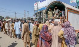 Coronavirus - People queue to buy wheat bags at a government food distribution point duringa government-imposed nationwide lockdown as a preventive measure against the COVID-19 coronavirus, in Multan on March 28, 2020. (Photo by SHAHID SAEED MIRZA/AFP via Getty Images)