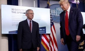 Coronavirus - US President Donald Trump departs the daily coronavirus task force briefing while walking past Dr. Anthony Fauci (L), director of the National Institute of Allergy and Infectious Diseases in the press briefing room at the White House on March 31, 2020 in Washington, DC. (Photo: Win McNamee/Getty Images)