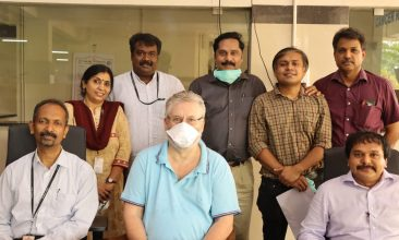 Coronavirus - Brian Neil (C) with the staff at Government Medical Collge in Ernakulam, Kerala.