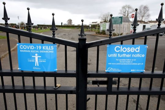 Coronavirus - Signs on the gates of Sixmile Cemetery in Antrim, warn that COVID-19 can kill, and that visitors must adhere to the social distancing guidelines, near Belfast, in Northern Ireland on April 2, 2020, as life in the United Kingdom continues during the nationwide lockdown to combat the novel coronavirus COVID-19 pandemic. (Photo: PAUL FAITH/AFP via Getty Images)