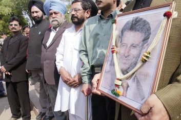 HEADLINE STORY - An activist of All India Anti-Terrorist Front hold a photograph of slain American journalist Daniel Pearl as they pay homage in New Delhi 24 February 2002.  PRAKASH SINGH/AFP via Getty Images)