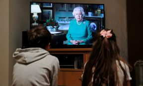Coronavirus - Noah (9) and Milly (7) watch Britain's Queen Elizabeth II during a televised address to the nation at their home, as the spread of the coronavirus disease (COVID-19) continues, Hertford, Britain, April 5, 2020. REUTERS/Andrew Couldridge