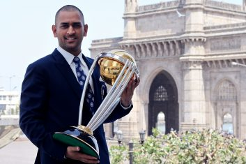 CRICKET -  India's cricket team captain Mahendra Singh Dhoni poses with the  ICC Cricket World Cup Trophy, with the Gateway of India in the backdrop, during a photo call at the Taj Palace Hotel on April 3, 2011 in Mumbai, India.  (Photo by Ritam Banerjee/Getty Images)